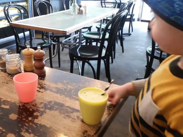 Inside the Pepper Cafe - J has his juice but before that they brought him a plastic cup for the water automatically. Nice touch.