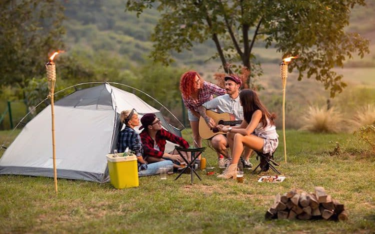 Sunset in camp in nature with guitar and drinks